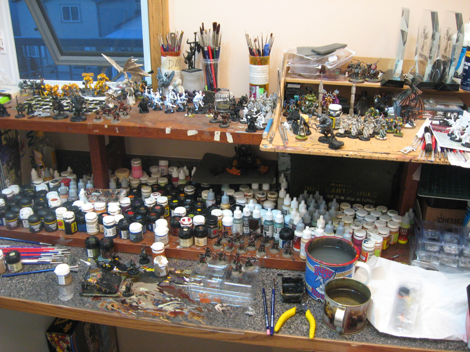 You Can See More Paints And Half Finished Projects Scattered About A Selection Of Oft Used Brushes Lies To The Left Dominant Features Items Cups